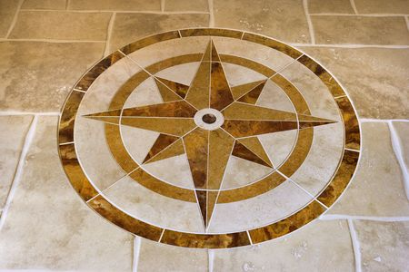 inlay: Marble floor with star shape in affluent home.