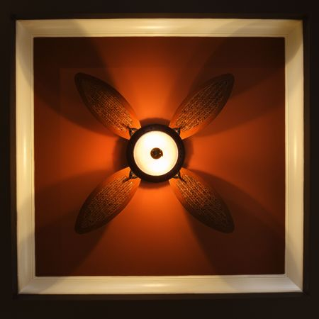 fan ceiling: Low angle view of ceiling fan lamp. Stock Photo