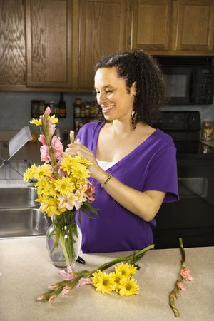 Portrait of young pregnant mother arranging flowers. Stock Photo - 2227066