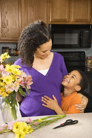 Portrait of expecting mother and son in kitchen. Stock Photo - 2227090