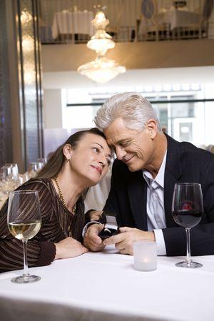 prime adult: Caucasian mature adult male proposing to prime adult female.