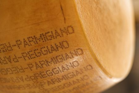 stamped: Hunk of stamped parmigiano cheese. Stock Photo