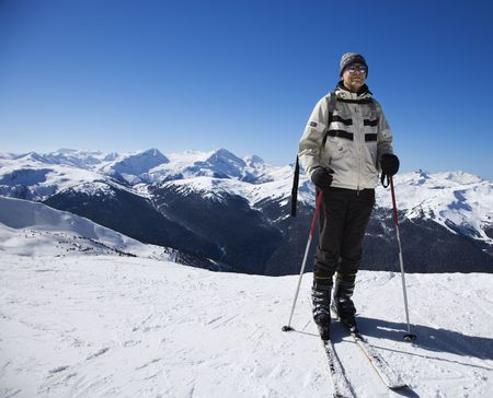 Caucasian senior male skier on slopes. photo