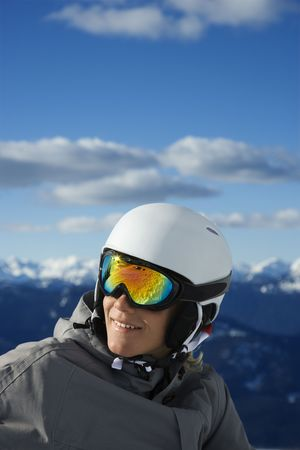 only one teenage boy: Caucasian teenage boy  snowboarder wearing helmet and goggles on mountain. Stock Photo