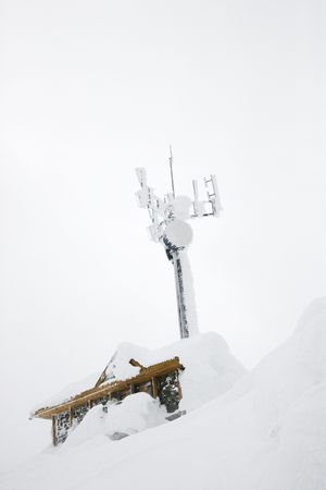 Cabin and antenna covered in snow. photo