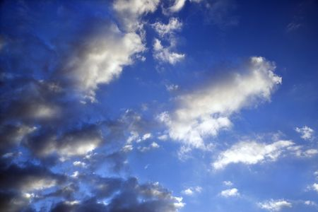 wispy: Wispy cloud formations against clear blue sky.