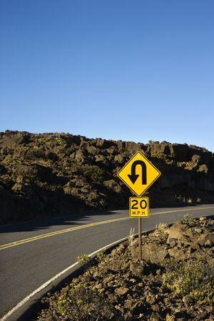 treacherous: Road and curve in road sign in Haleakala National Park, Maui, Hawaii.