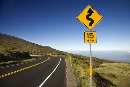 curvy: Curvy road sign in Haleakala National Park, Maui, Hawaii.