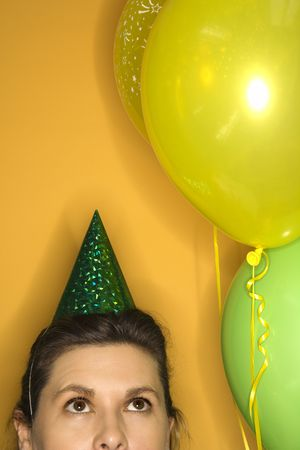 prime adult: Caucasian prime adult female wearing party hat. Stock Photo