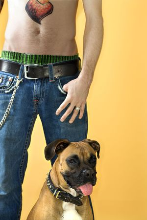 nonconformity: Young adult Caucasian male with Boxer dog.
