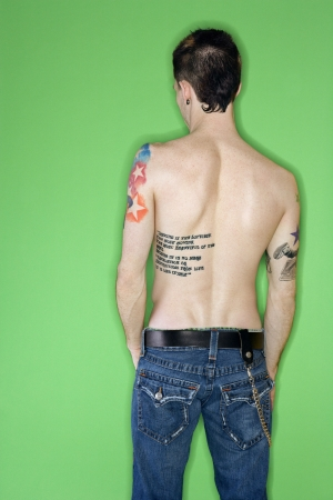 nonconformity: Rear view of tattooed young adult Caucasian male. Stock Photo