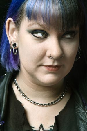 pierce: Head shot of Caucasian woman with blue hair looking off to side.