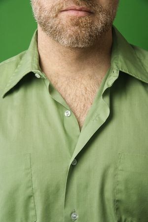 open collar: Close-up of Caucasian man lower half of face with beard and shirt with collar open. Stock Photo