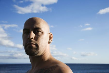 Caucasian prime adult bald male portrait on beach. photo