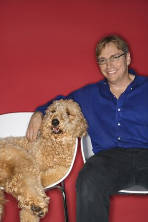 Middle-aged Caucasian man with Goldendoodle dog. photo