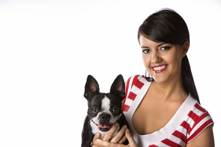 boston terrier: Young adult female Caucasian holding Boston Terrier dog.
