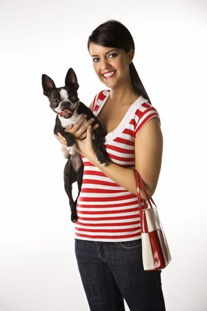 Young adult female Caucasian holding Boston Terrier dog. photo