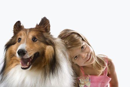 lassie: Female child Caucasian with Collie dog.