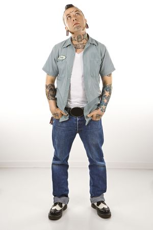 nonconformity: Caucasian mid-adult man with tattoos and piercings. Stock Photo