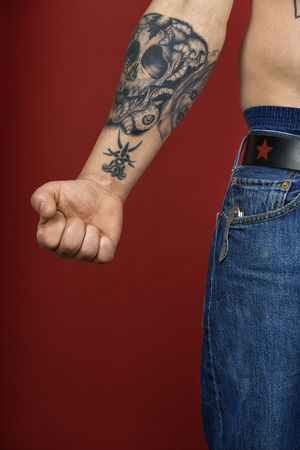 arm tattoo: Caucasian mid-adult mans arm with tattoo. Stock Photo