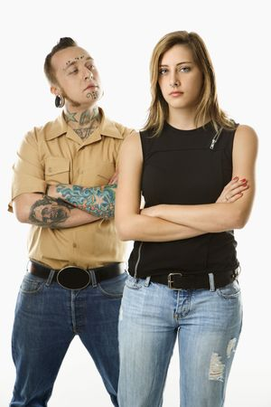nonconformity: Caucasian mid-adult man looking at teen female who is looking away.