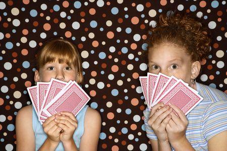children at play: Caucasian female children holding cards. Editorial