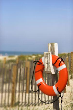 bald head island: Life preserver hanging on post on beach on Bald Head Island, North Carolina.