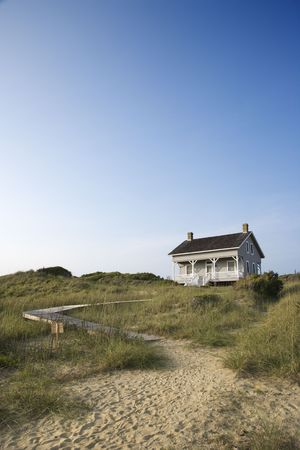 bald head: Coastal house with pathway to beach on Bald Head Island, North Carolina.