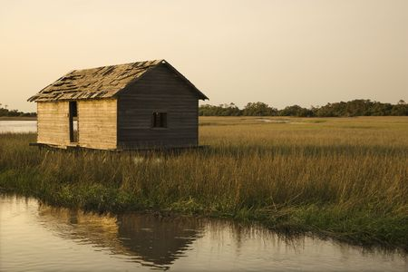 bald head island: Worn out building in marsh on Bald Head Island, North Carolina. Stock Photo