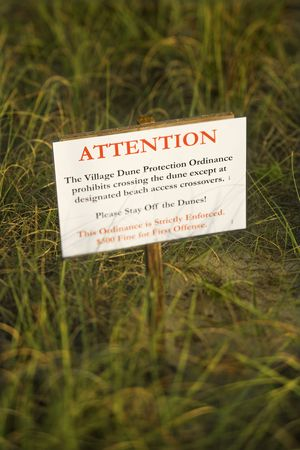 designated: Beach access stay off dunes warning sign. Stock Photo