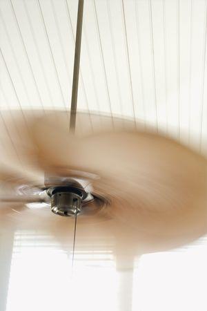 ceiling fan: Ceiling fan with motion blur.