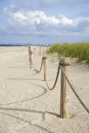 barrier: Rope fence barrier on beach.