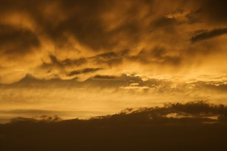 bald head island: Golden yellow and orange sunset sky and clouds. Stock Photo