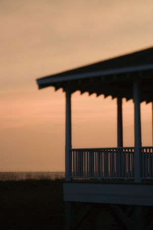 beachfront: Beachfront porch silhouetted at sunset