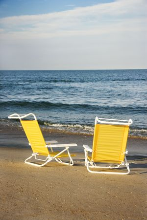 bald head island: Empty lounge chairs on beach on Bald Head Island, North Carolina.