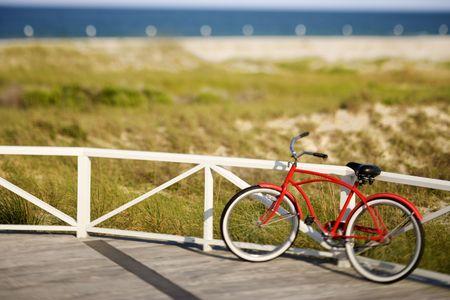 beach cruiser: Bicycle leaning against rail on Bald Head Island, North Carolina