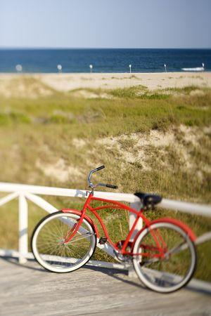 bald head island: Bicycle leaning against rail on Bald Head Island, North Carolina