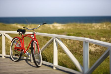 bald head: Bicycle leaning against rail on Bald Head Island, North Carolina
