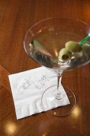 rejecting: Martini and note on napkin reading get lost.
