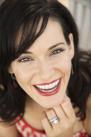 Mid-adult Caucasian woman smiling wearing wedding ring. photo