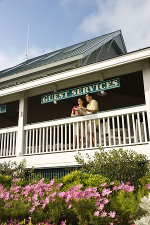 bald head island: Mid-adult couple on deck of guest services at Bald Head Island, North Carolina. Stock Photo
