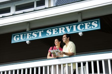 Mid-adult Caucasian couple looking out at guest services at Bald Head Island, North Carolina. photo