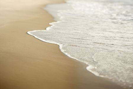 Image of sandy beach with waves. photo
