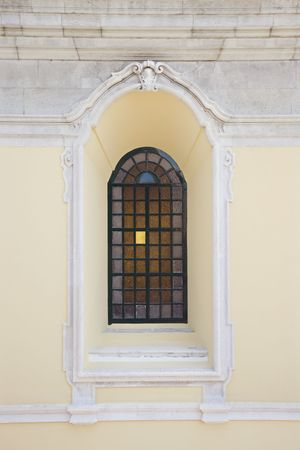recessed: Recessed window with colored panes in building in Lisbon, Portugal.