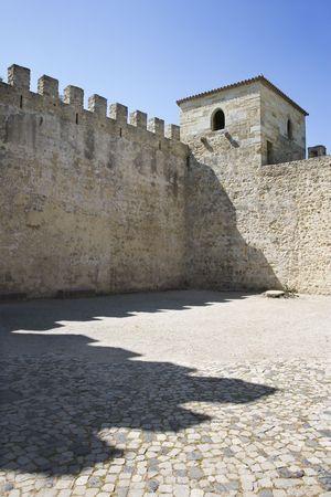 crenelation: Castle structure in Lisbon, Portugal.