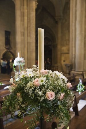 se: Interior with flower bouquet and candle of Se Cathedral, Lisbon, Portugal.