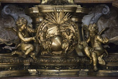 Sculpture of cherubs and Creation in Saint Peters Basilica, Rome, Italy. Editorial