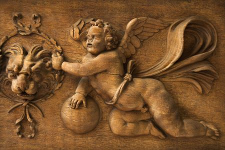 vatican: Close-up wood carving of cherub angel in the Vatican Museum, Rome, Italy. Stock Photo