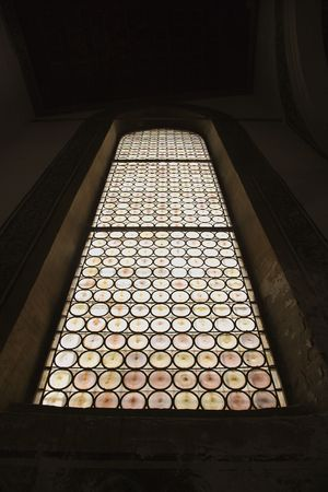 glasswork: Indoor low angle view of stained glass window. Stock Photo