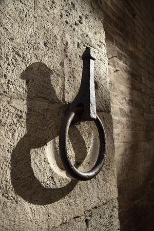 hitching post: Metal hitching post on stone wall. Stock Photo